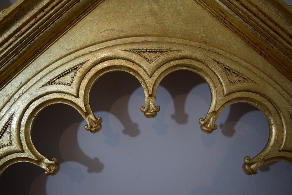 Detail of the top tracery of the frame's opening.