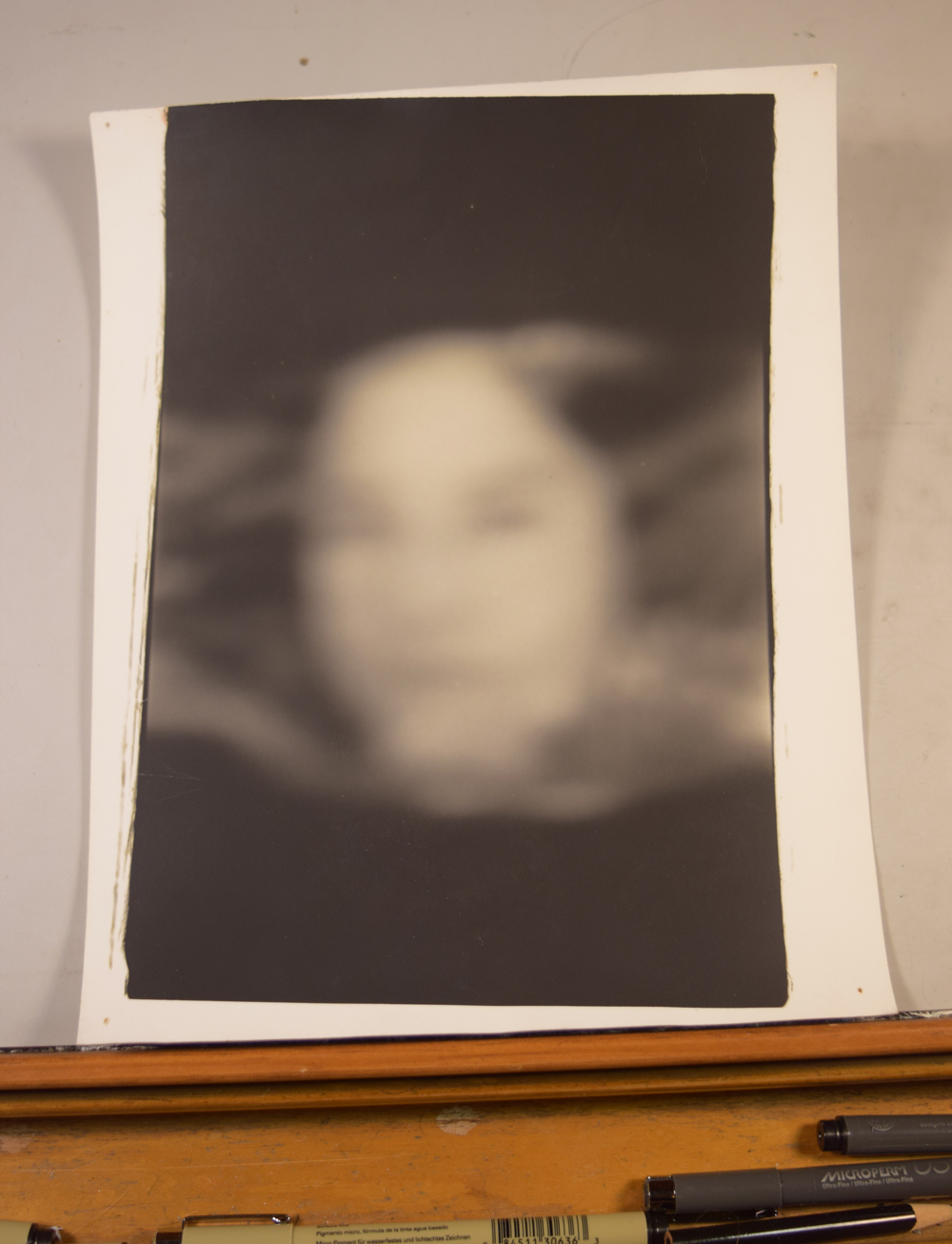 The photograph selected for the cover of Face of Collapse. This was taken with a piece of plastic wrap over Anna's face. I really had no idea what kind of imagery I had until I entered the photo lab and began developing the negatives. This photograph spoke to me right away.