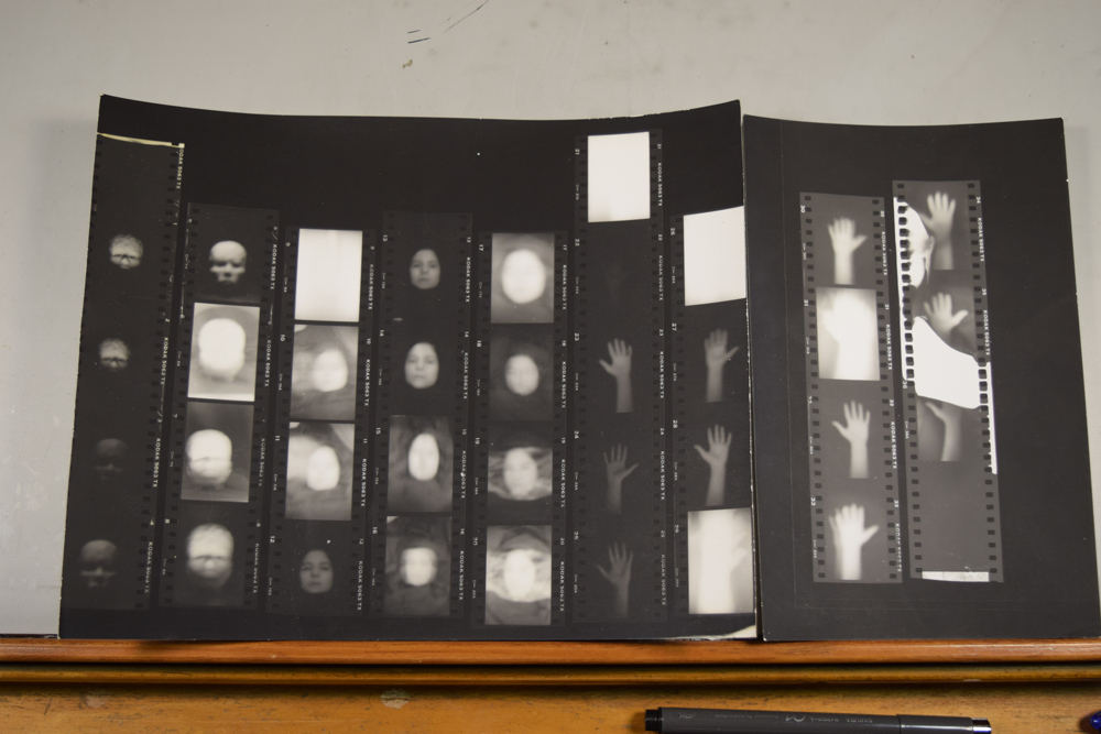 The original 35mm contact proof sheets for Dazzling Killmen's Face of Collapse. The first two strips show a clay head I sculpted. Strips 3-5 show Anna Cimini in different poses with varied lighting and exposures. Strips 6-9 show different experiments with Anna's hands.
