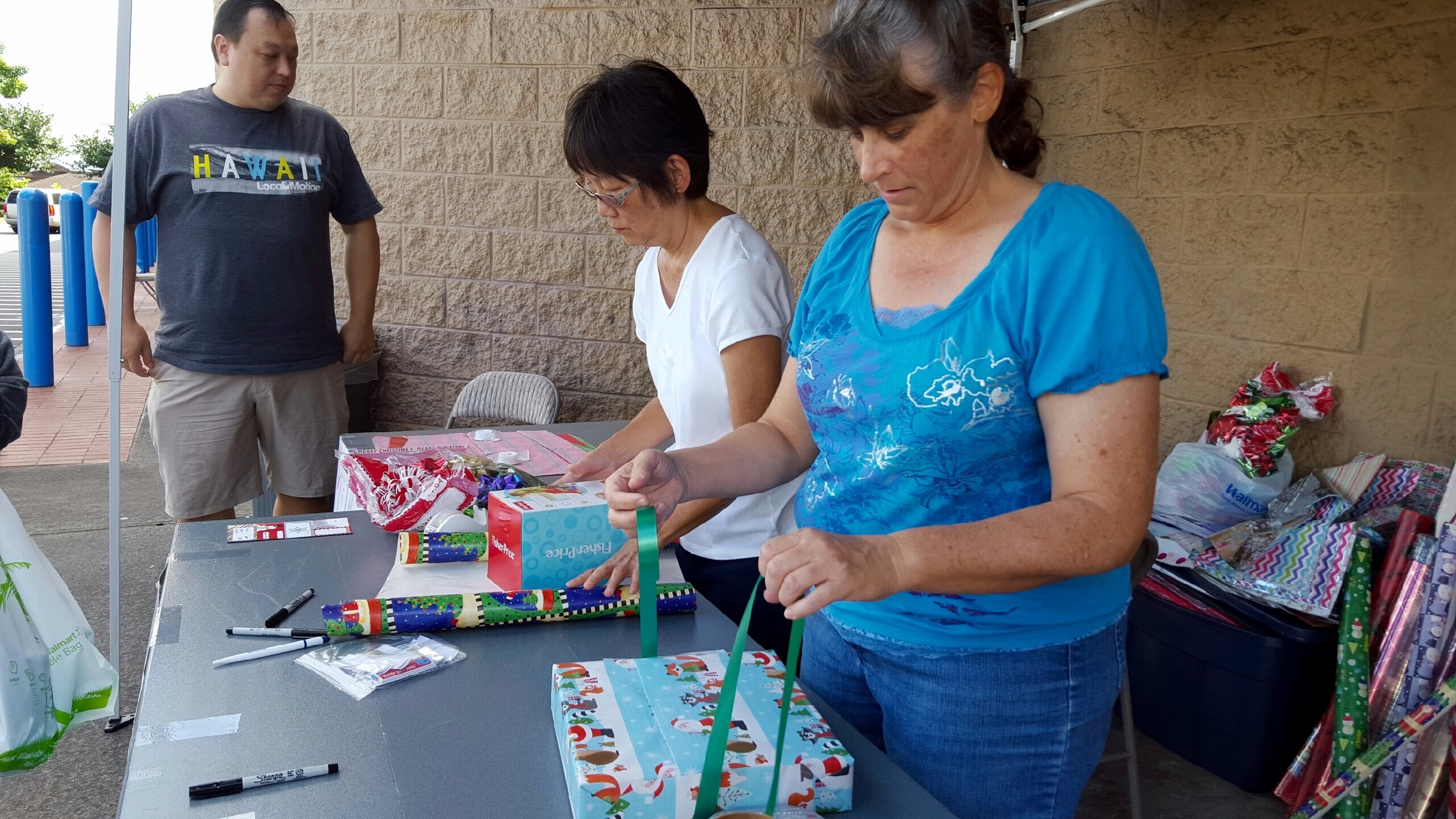 Pastor Alan and Mililani Baptist Members Wrapping Christmas Gifts
