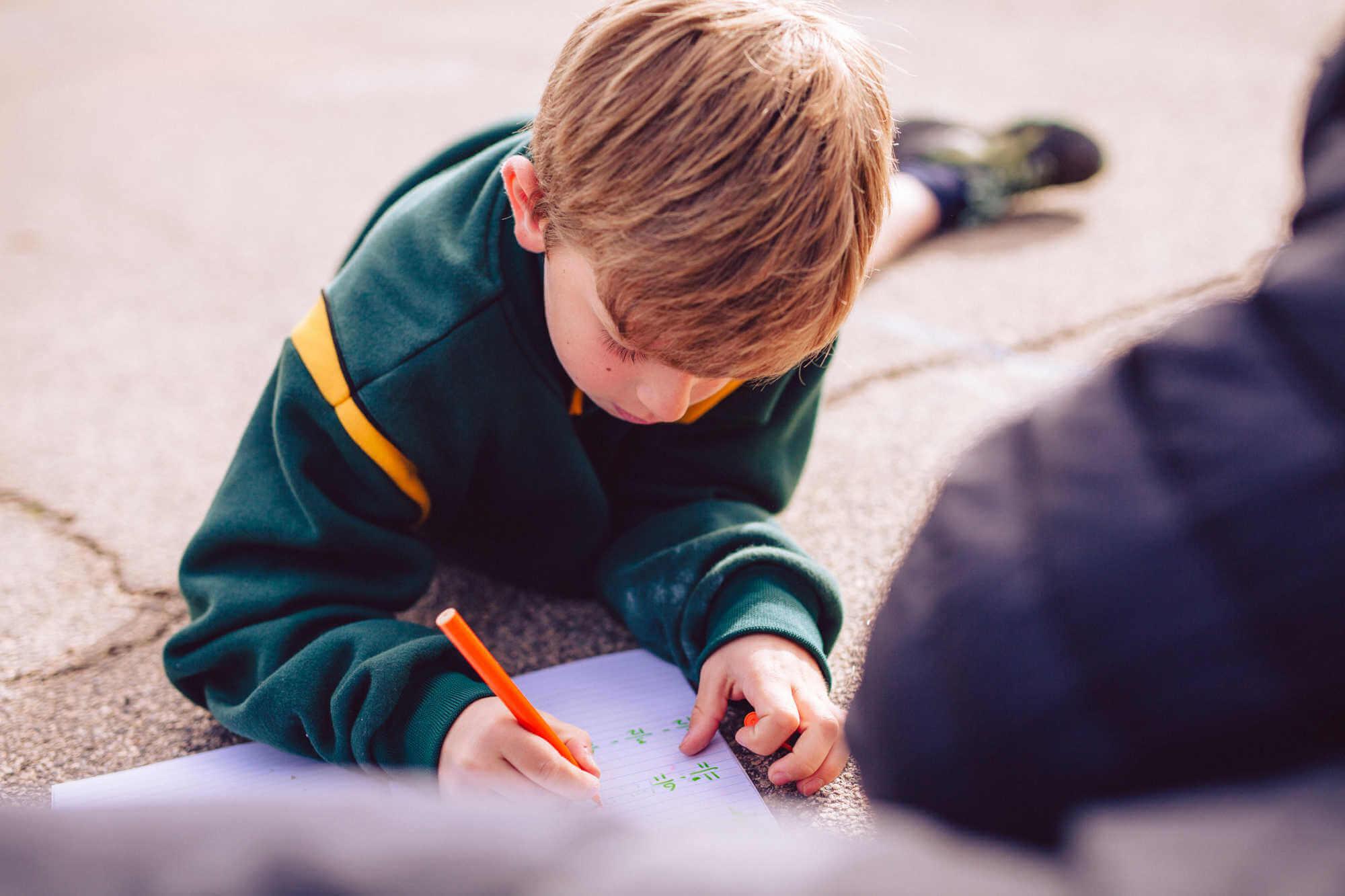 student-tutoring-outside.jpg