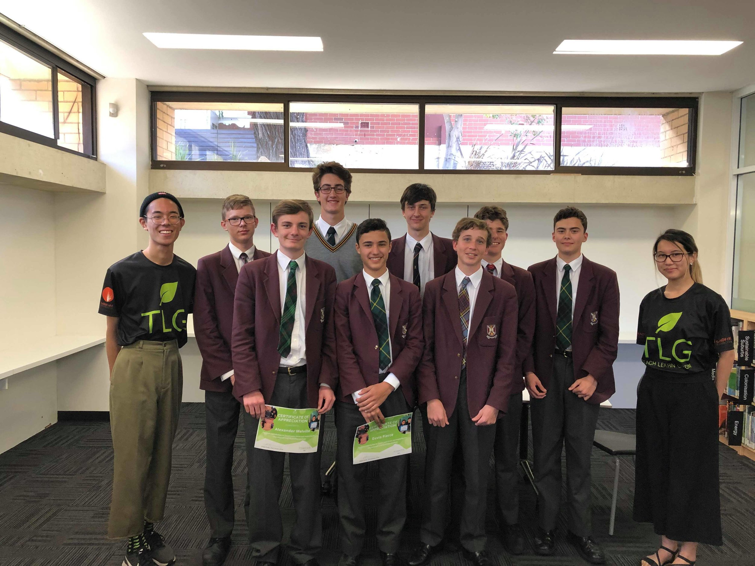 TLG Volunteers Max Tran (Marketing Manager) and Ngoc-Mai Duong (Community Outreach Officer) with year 10 Scotch College students.