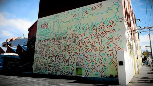 The heritage listed Haring Mural on the side of Collingwood College in Melbourne, created during his trip to Australia in 1984.