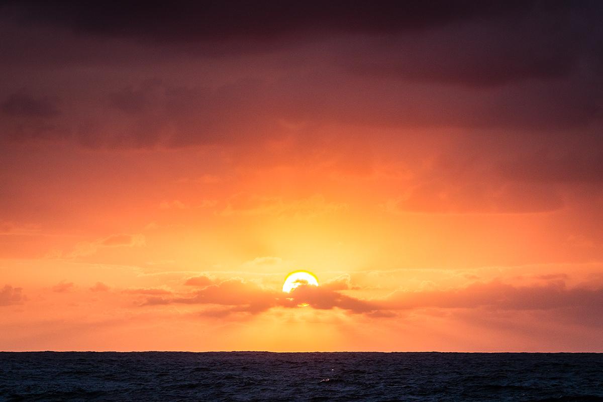 Sun rays bursting through the thin cloud.