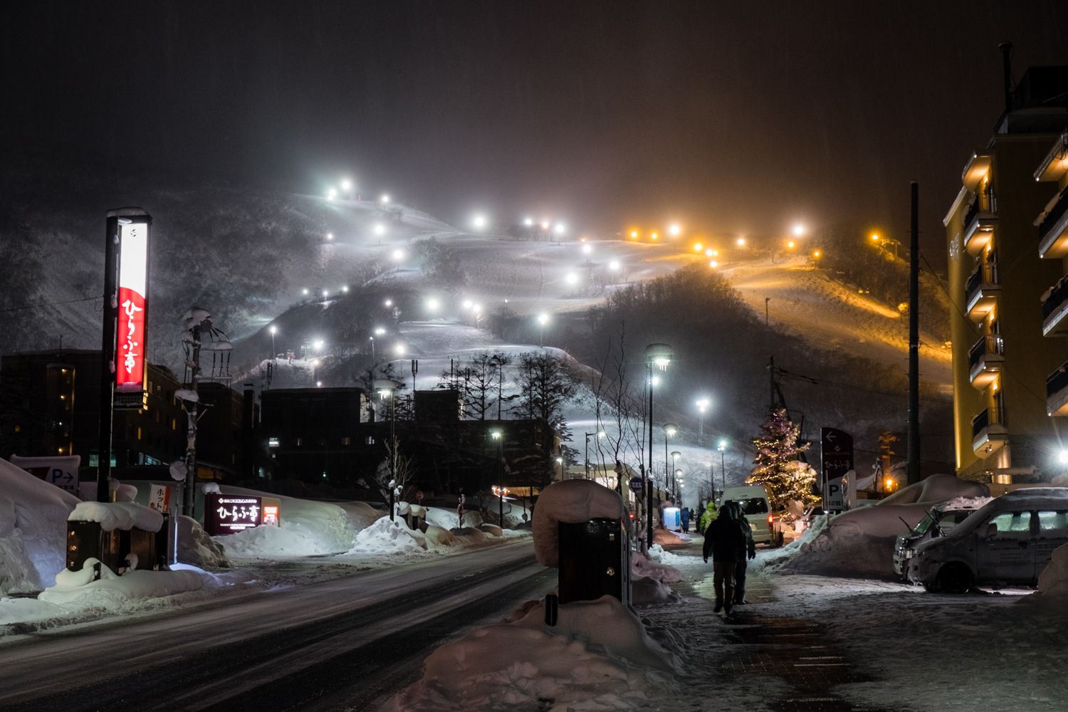 Looking up at Grand Hirafu with the floodlights on for night skiing.