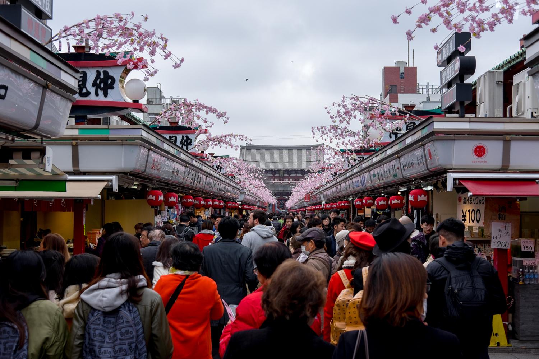 Dense crowds shuffling through the markets.