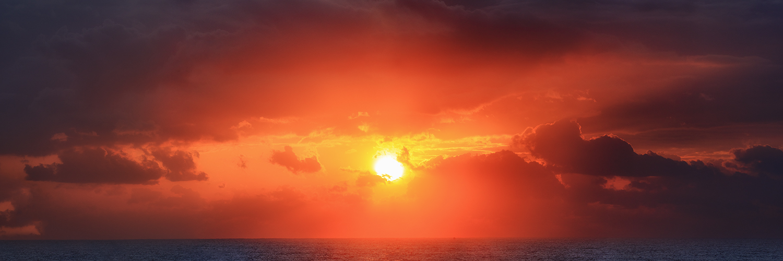 Sun rays bursting through the cloud.