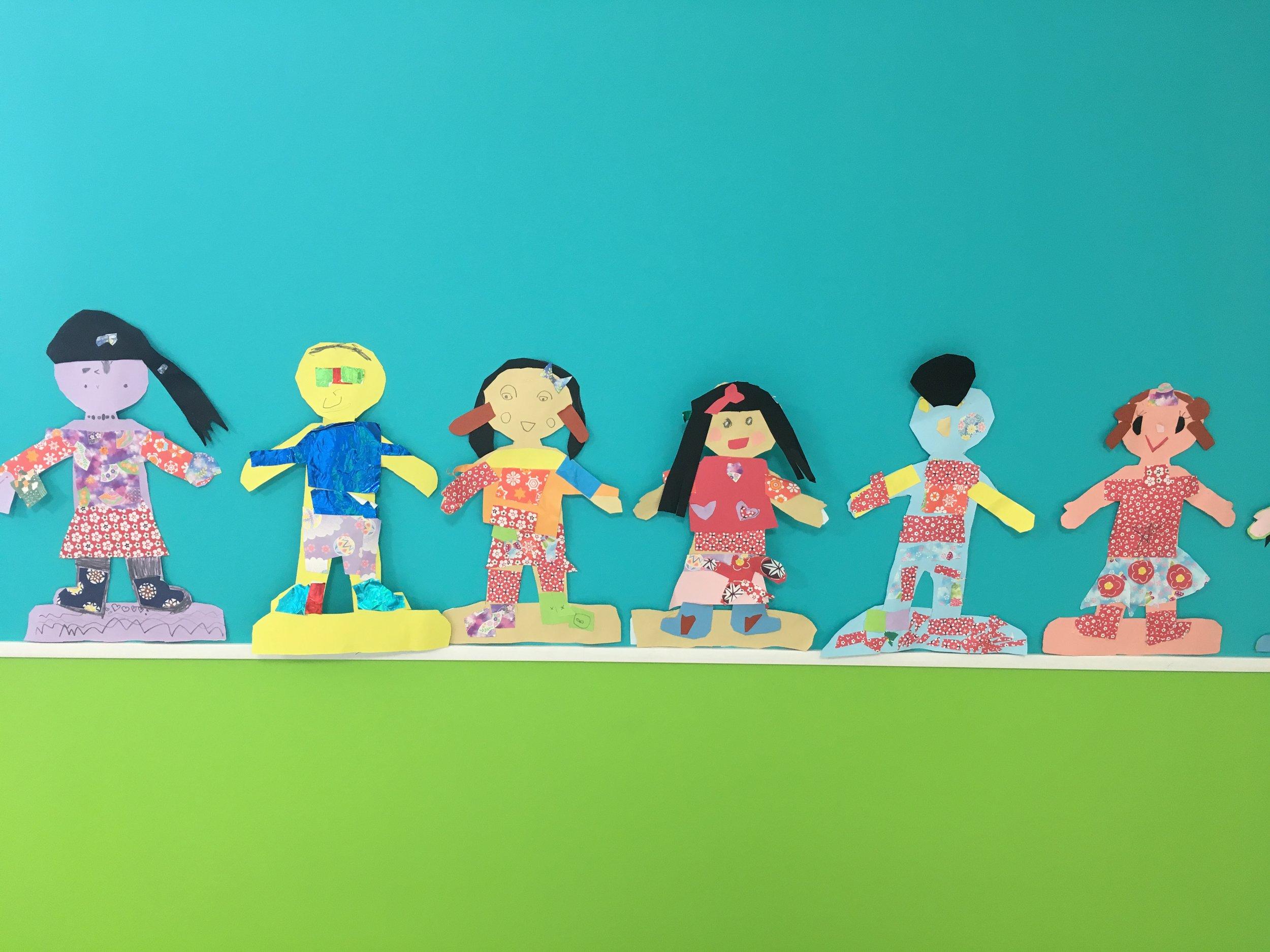 Dressed paper dolls