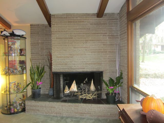 Burgess House stone fireplace and beamed ceiling