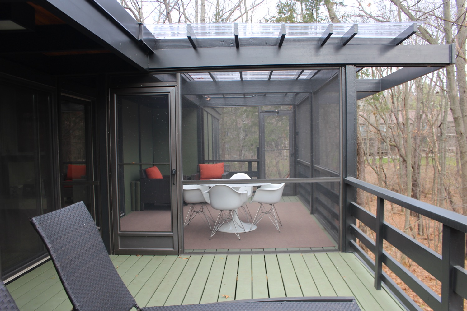 BACK DECK OFF LIVING ROOM WITH TRELLIS OVERHANG AND SCREENED PORCH