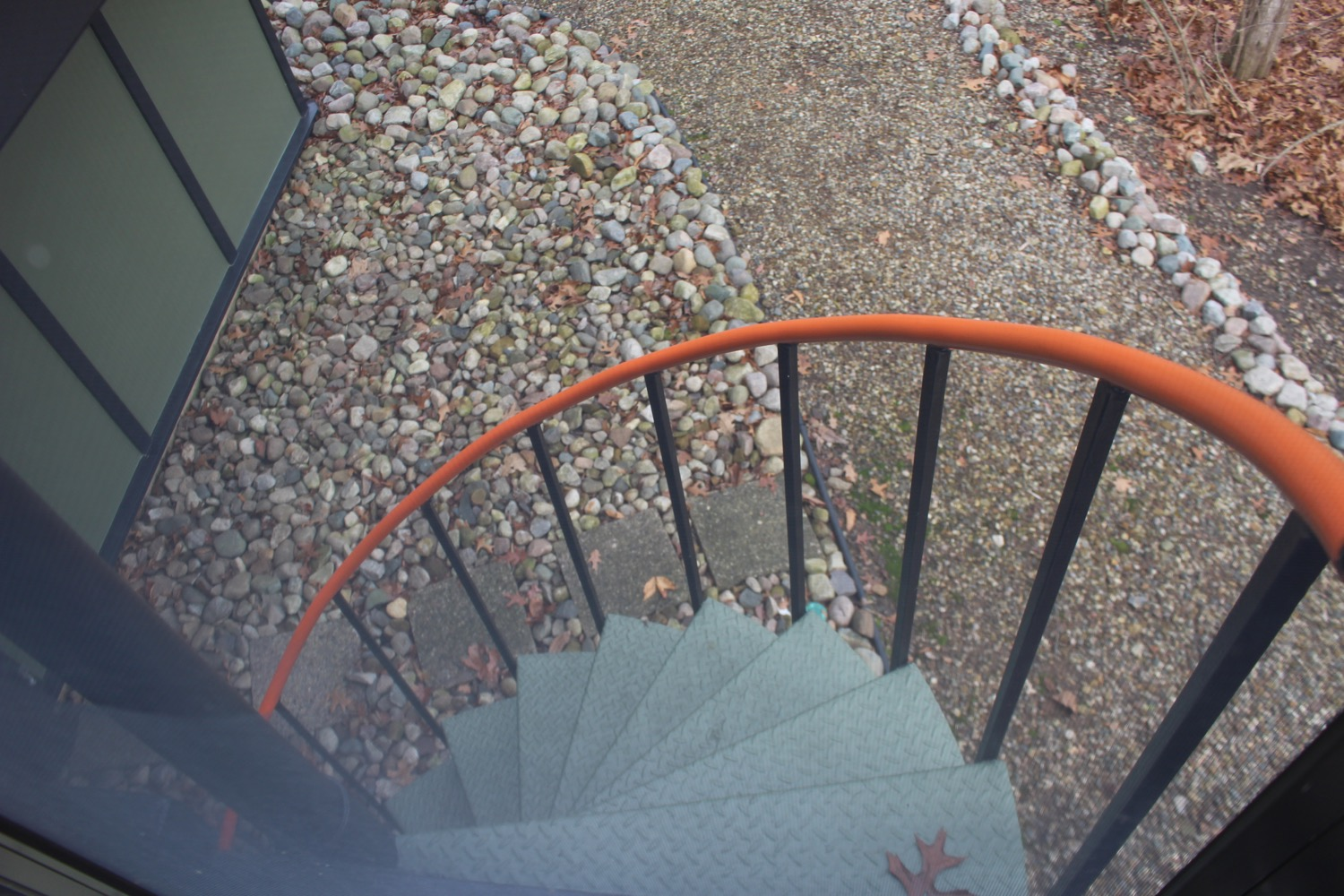 CIRCULAR STAIR FROM DECK DOWN TO BACKYARD