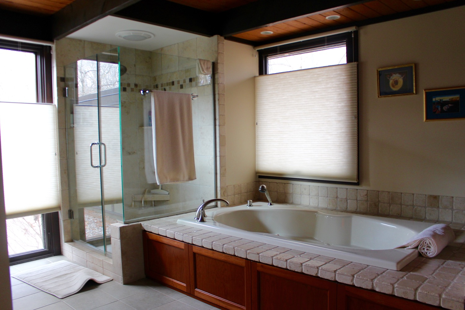 ENLARGED MASTER BATH WITH NEW 12 INCH FLOOR TILES, TILED SHOWER WITH GLASS WALLS, GARDEN TUB WITH TILE SURROUND