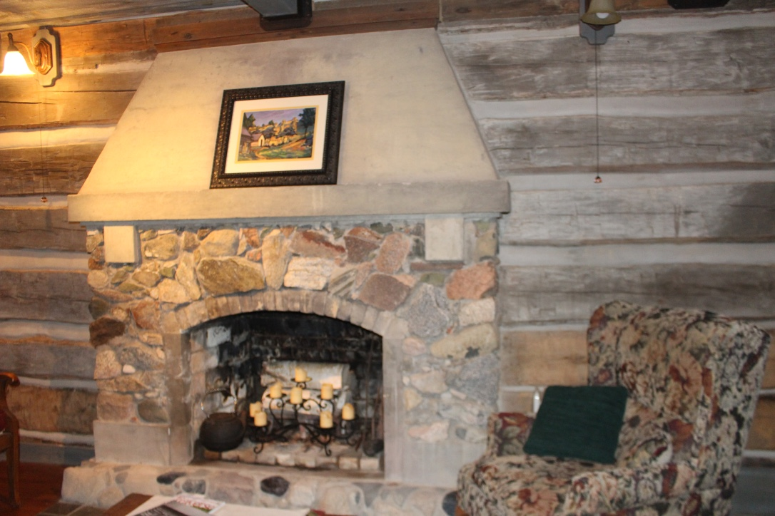 Cabin interior with fireplace designed by Manierre and cabin walls re-chinked by current owner Sharon Bluhm