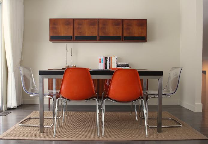 The Fox Family's dining room in their modern ranch home was furnished with a combination of contemporary furniture and vintage danish modern sideboard and cupboard.