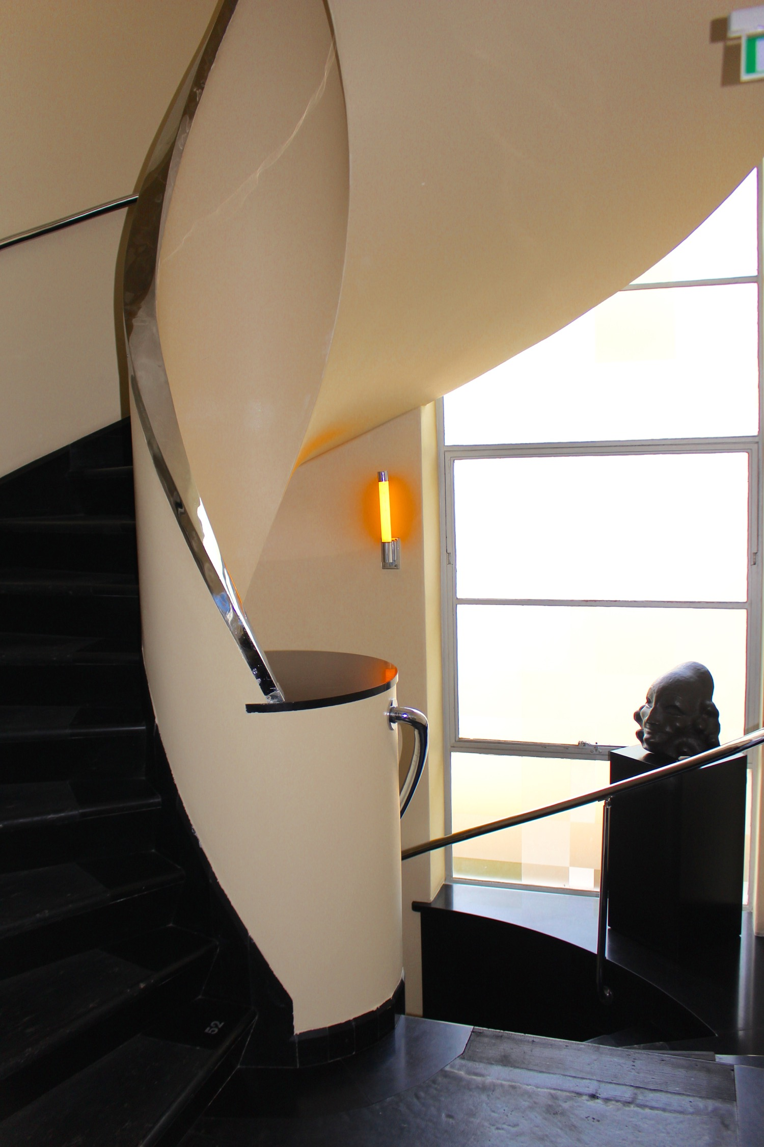 DRAMATIC CIRCULAR STAIRWAY CONNECTING THE FLOORS
