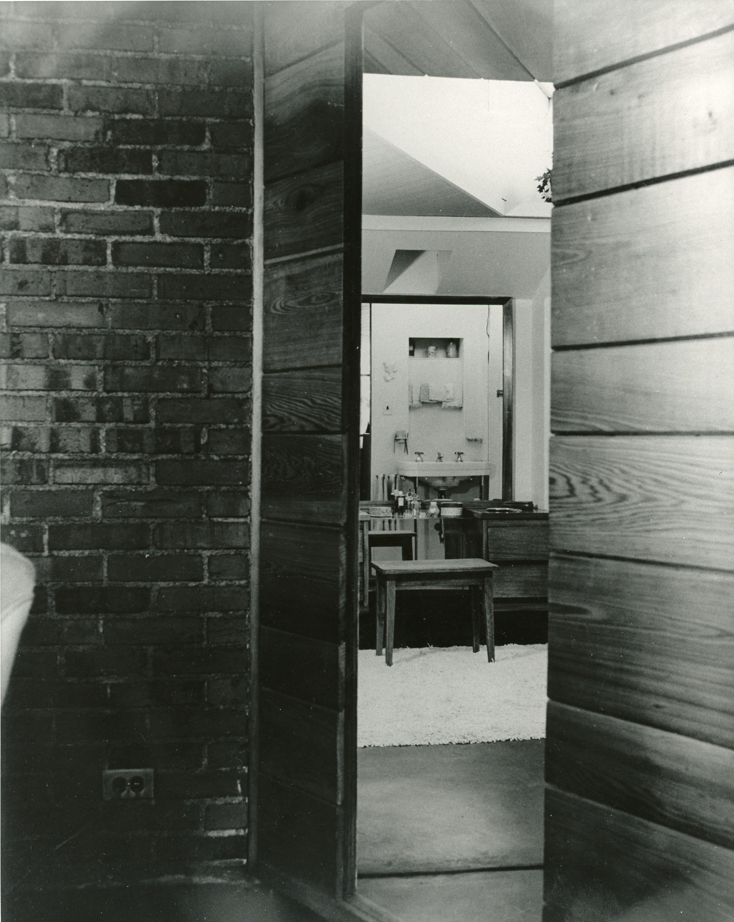 Door to hall and bathroom is hidden in the wall of cypress panelling.
