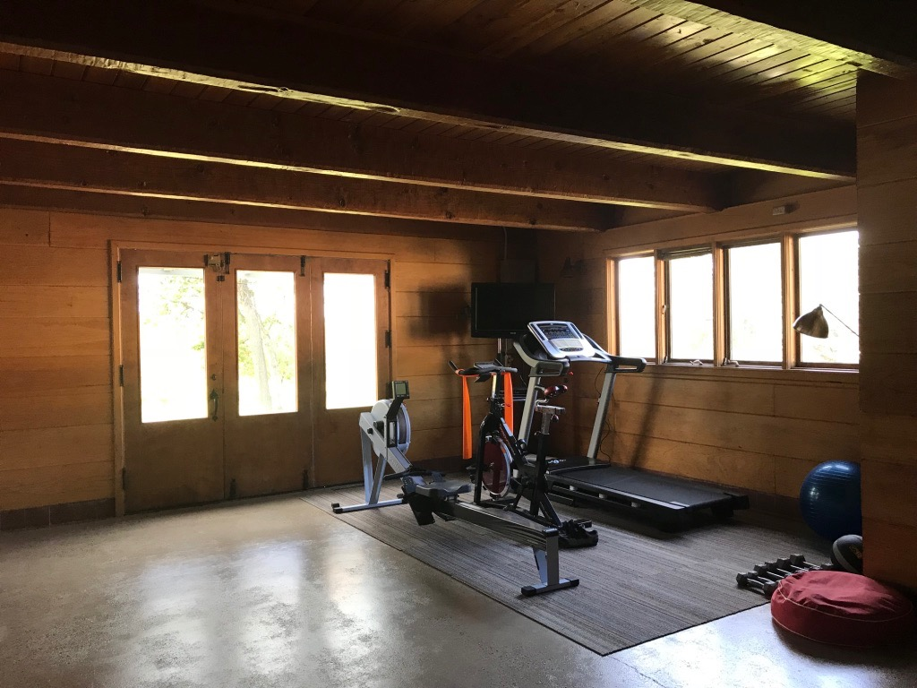 GYM IN CONVERTED SPECIALTY CAR GARAGE IN WALKOUT BASEMENT