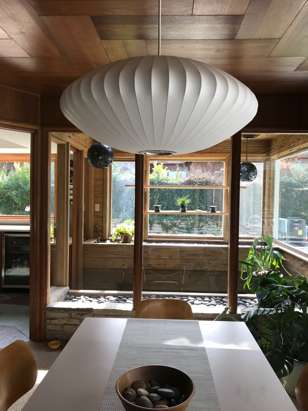 GEORGE NELSON BUBBLE LAMP OVER DINING TABLE