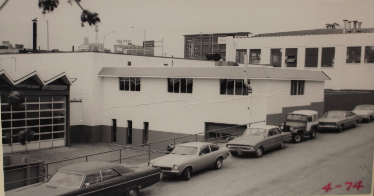 1974 photo of the Ronda Tire Building showing the connected warehouse building.  Photo Courtesy of City Archives.