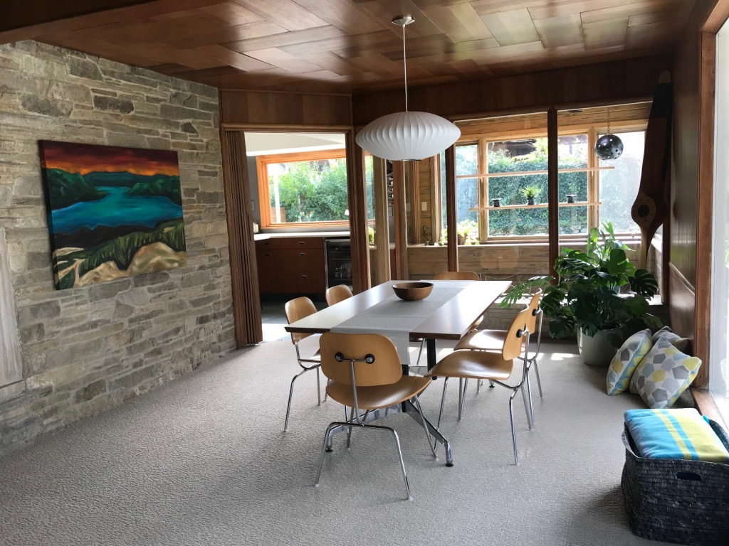 DINING ROOM WITH CUT-STONE WALL LOOKING AT GREENHOUSE