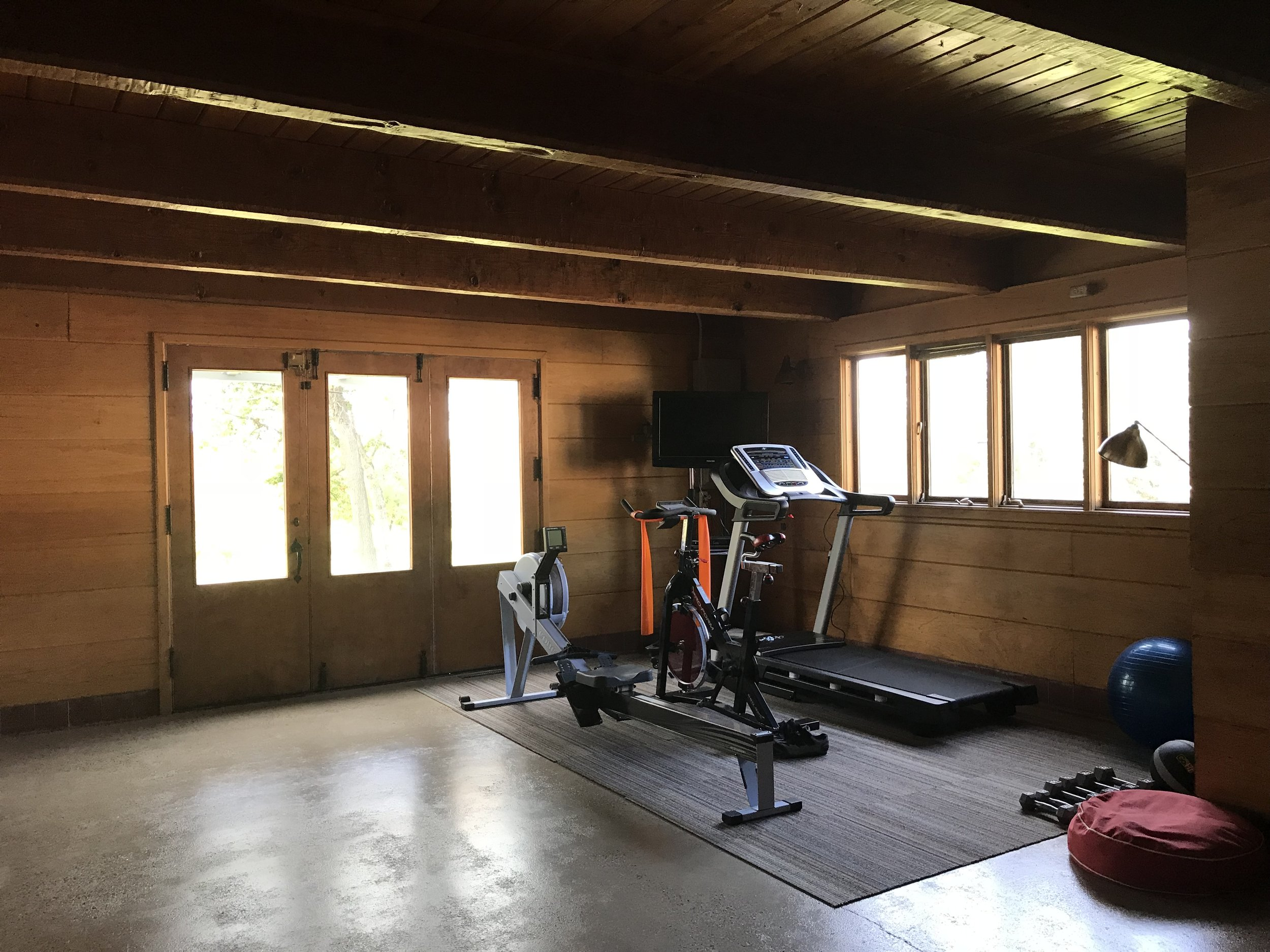 Current gym is located in the former specialty garage with triple doors to the outside.