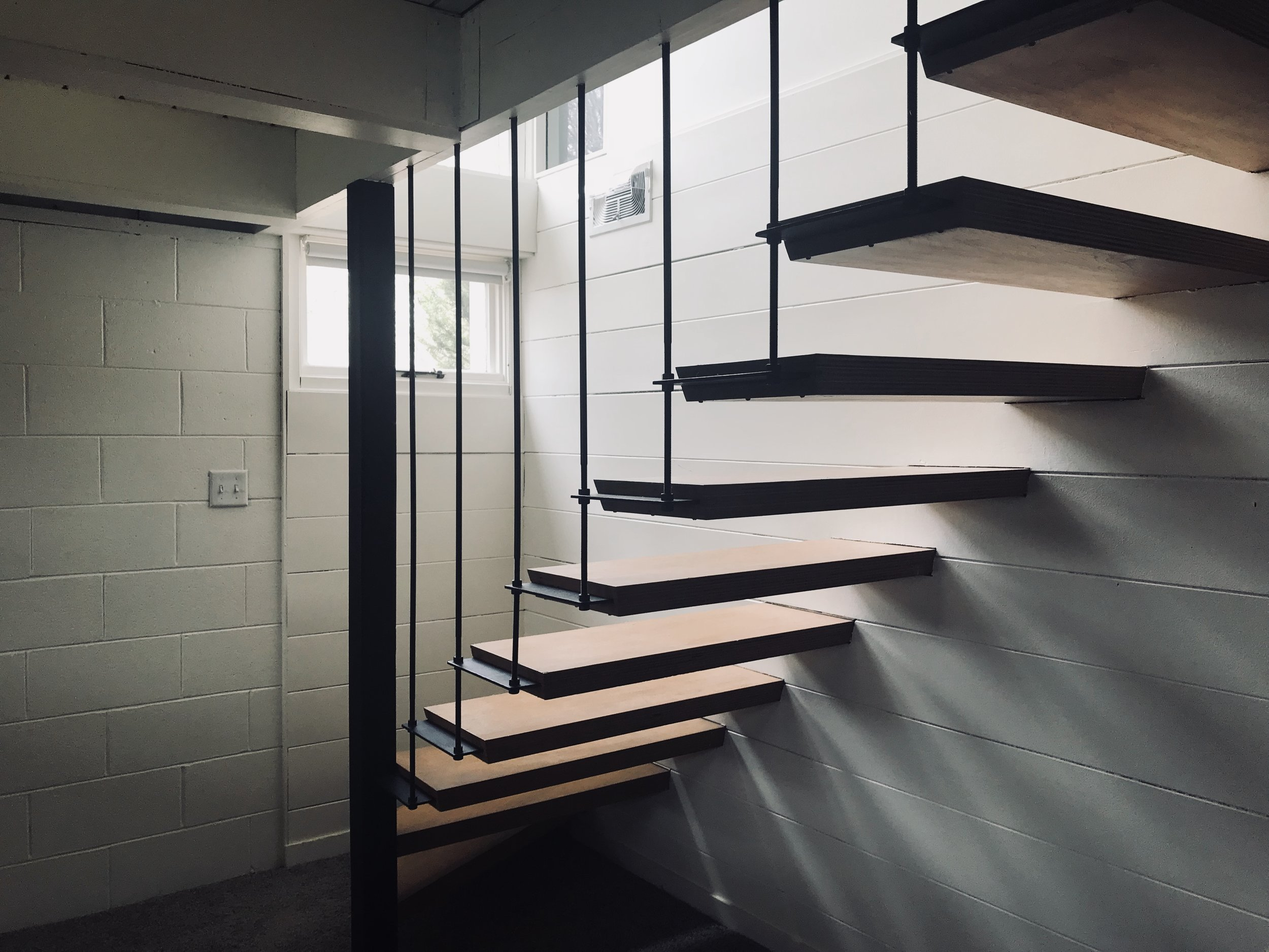 STAIRWAY WITH VIEW OF INDUSTRIAL RODS AND OPEN TREADS