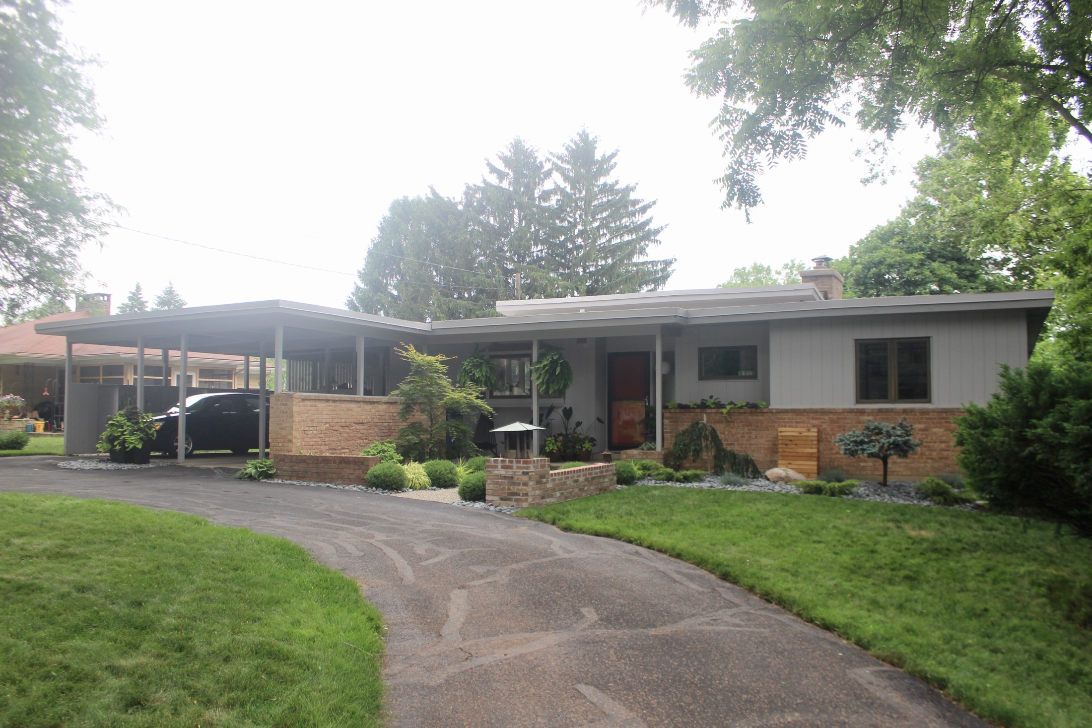 Exterior with view of carport and circular drive
