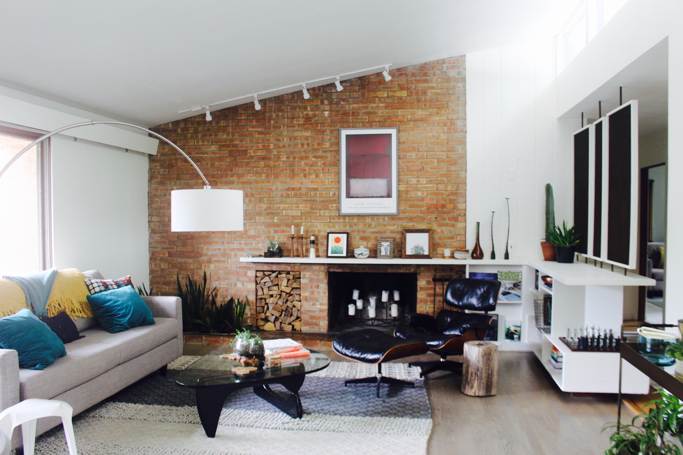 LIVING ROOM FIREPLACE AND ANGLED CEILING