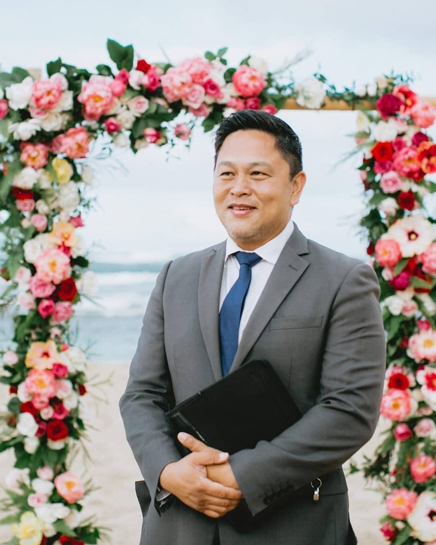 """A Wedding Celebrant Who Believes in Forever - Happily married for over twenty years, James Chun knows a thing or two about finding love that lasts. That's why he has spent the past decade building his reputation as one of Hawaii's most trusted and sought after officiants. Warm and charismatic, he has the ability to take your unique story and turn it into an intimate experience that feels authentically """"you"""".Visit WebsiteHonolulu, HawaiiPhone: 1 808 383 7090Email: oahuminister@gmail.com"""
