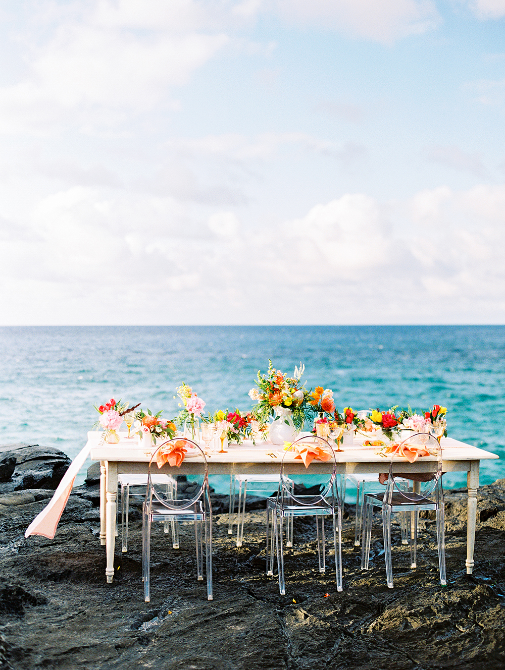 """Where to Start? - The first step to planning your Hawaiian wedding is selecting which of the main islands will kick off your happily ever after. The truth is, each island offers something completely different, so it's important to evaluate your own vision, budget, and the physical needs of your wedding day! Read below for a few tips we gathered from our island-hopping that will hopefully shed insight into your big decision.MauiMaui was a highlight of the trip for our team - a verdant, highly creative island where one can still find traces of the old-school, bohemian charm it has always been known for. It is perhaps the island with the most diversity in regards to nature and microclimates, but also offers a wide variety of luxury resorts and incredible, industry-recognized vendors who are centrally located to make it as easy as possible to hire them for your wedding day.OahuOahu is Hawaii's main island and hosts the city of Honolulu, the state's most buzzing metro area. For brides looking to accommodate a larger, more extravagant wedding without complications, this is the island we recommend. The Honolulu airport is an easy landing spot for international guests, and just outside of the city you will still find long stretches of beach with fabulous surf. Waikiki is lined with four star resorts and many of Hawaii's leading vendors call this island home, making it easily accessible for them even during busy weekends.The Big IslandThe biggest isle of Hawaii, Big Island is an incredible vast landscape of microclimates, ranging from verdant green hillsides to black lava fields. The island hosts many volcanoes - both snowy and actively spouting lava - as well as the renowned Mauna Kea Observatory, where visitors can enjoy exceptional stargazing. Most of The Big Island's resorts can be found on the west coast near Kona and have been made popular for their coral reefs and quiet beaches.KauaiOften called """"The Garden Isle,"""" Kauai is well known as Hawaii's most lush and tropical"""