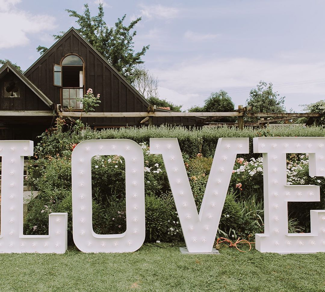 Well Travelled Bride Queenstown Wanaka Wedding Love Sign Lumina Signs.jpg
