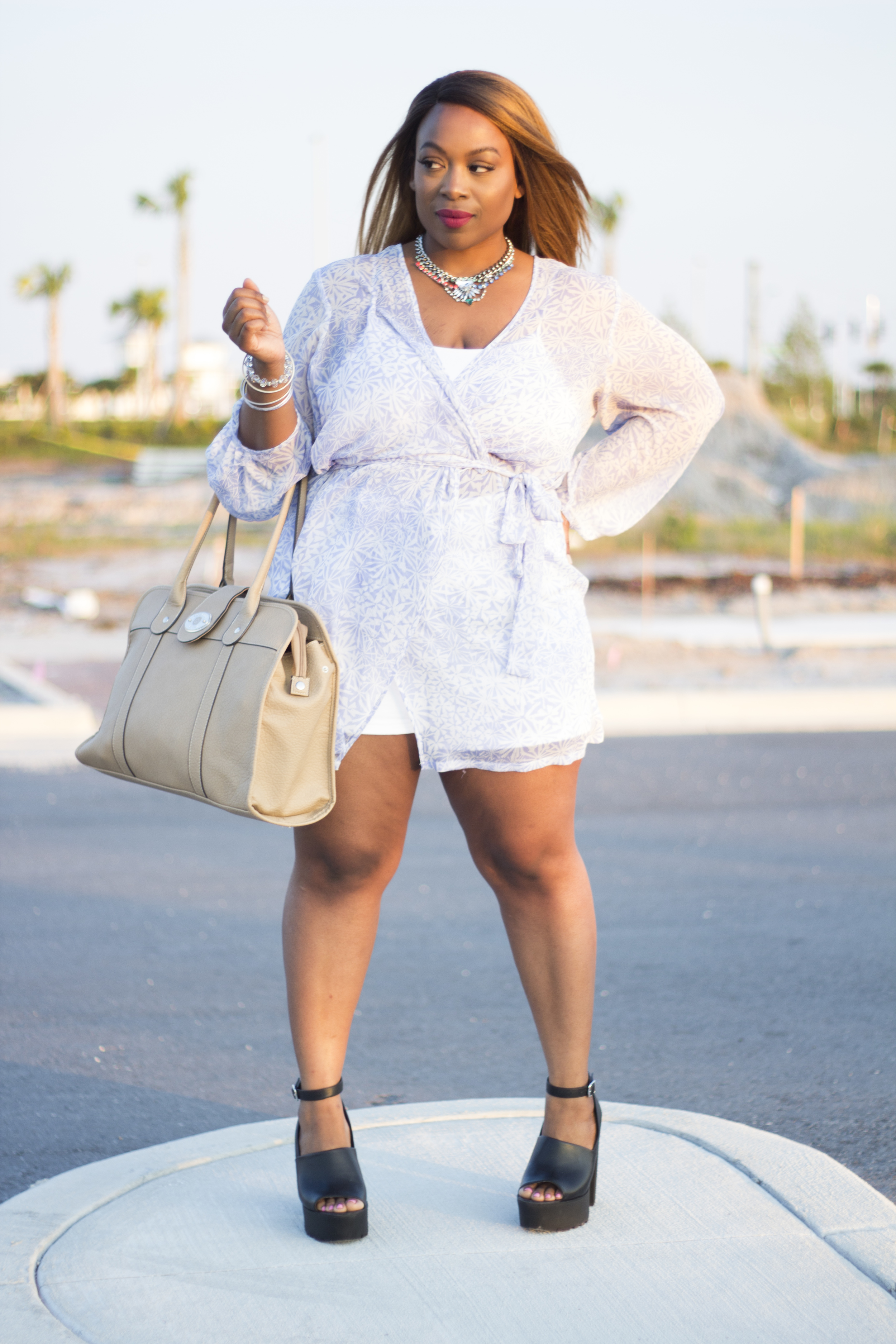 I paired this sheer Oscar de la Renta robe ( similar ) with a bralette and a pair of thrifted white denim shorts. These  edgy platforms  give this look a 'kick' and I'm sporting my new 'diaper bag' for utility.   WATCH THE MOVING BLOG POST  HERE .