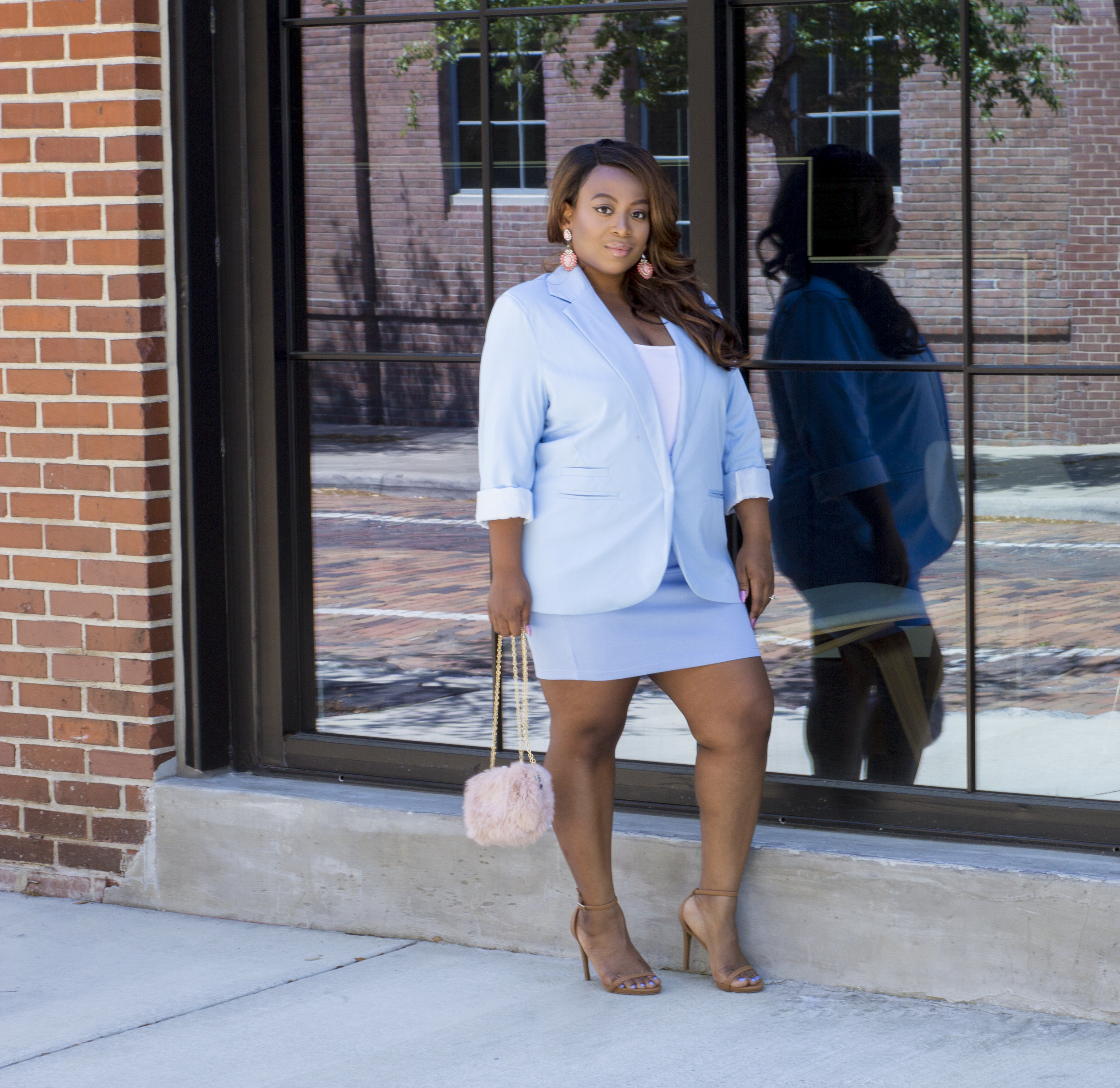I paired this 'suit' look with some pink drop earrings and a fuzzy pink bag for a bit of playfulness. The nude heels are simple and minimalistic, keeping all of the focus on the outfit.