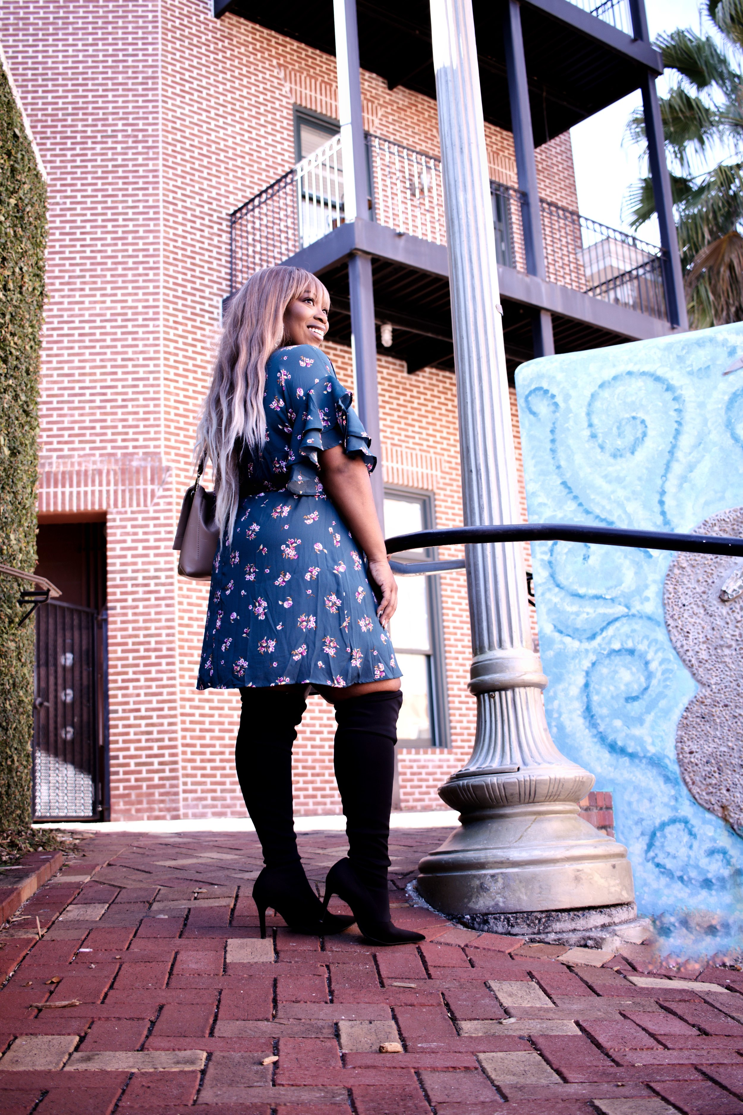 GET THIS FLORAL WRAP DRESS HERE  I LOVE THE RUFFLES ON THE SLEEVES BECAUSE THEY FLATTER MY ARMS