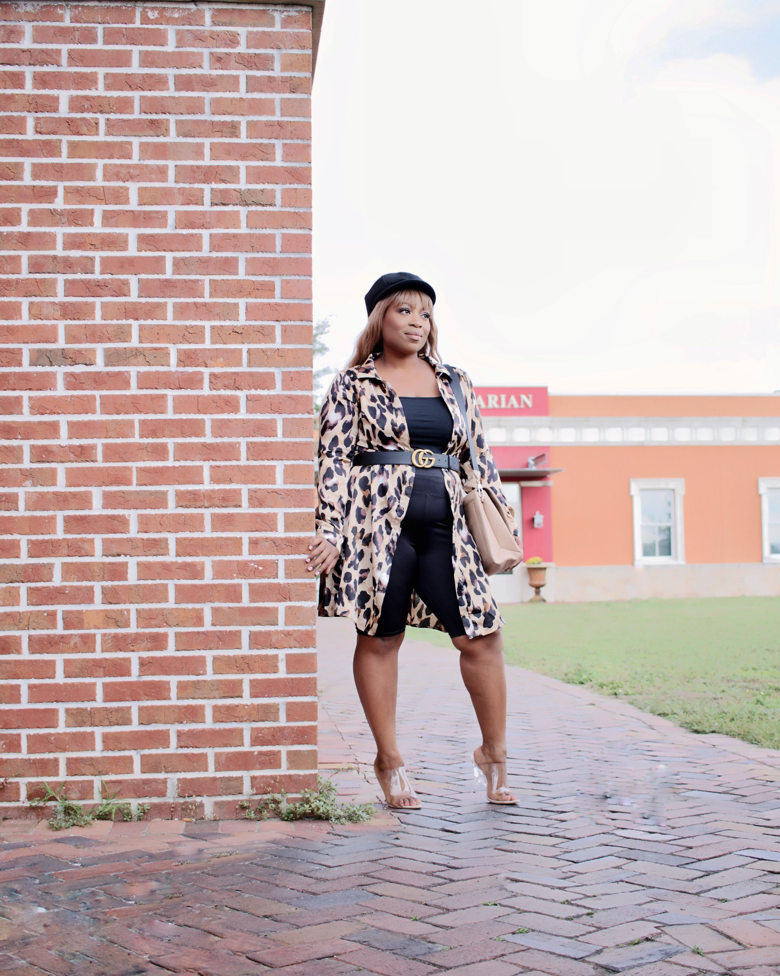 LEOPARD PRINT SHIRT DRESS/KIMONO (SIMILAR)   KIMONO STYLE TOPS ARE GREAT FOR MAKING YOU LOOK SLEEK AND SLIM, ESPECIALLY WHEN WORN ON TOP OF A DARK BODY SUIT OR TOP AND LEGGINGS.