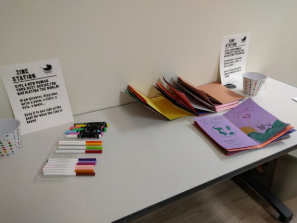 Zine station that was set up for guests to leave advice for any new humans joining this world.