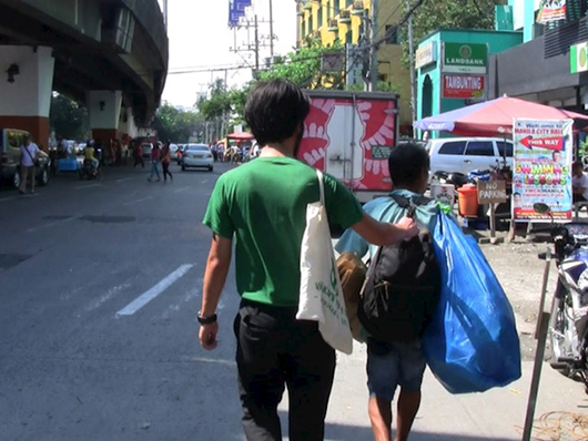 Donating Money to People in Manila Without Notice , 2014 Single Channel Video, 05'07