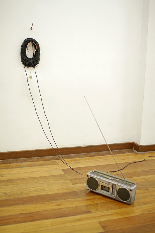 Kurohebi , 2014 Cables, Coil, Piezo, Tracing Paper and Radio Cassette Recorder, Variable Dimensions