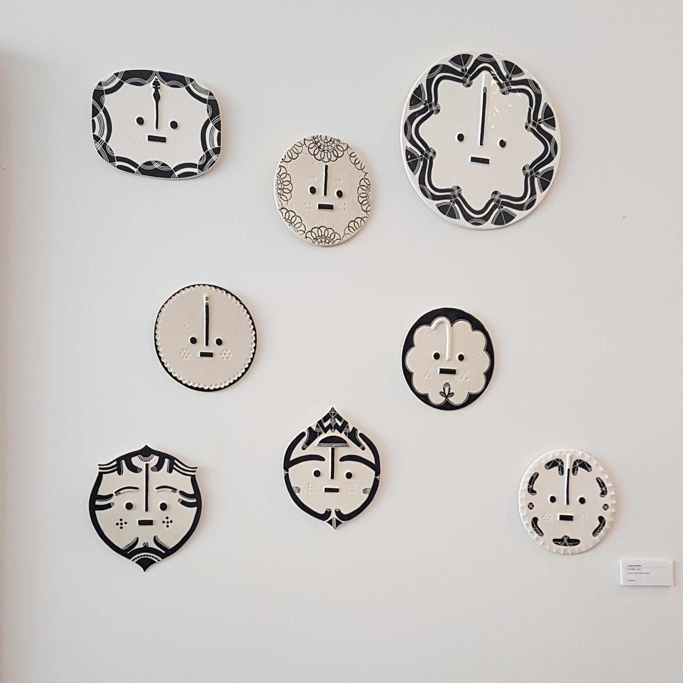 Ceramic faces by Louise Kyriakou