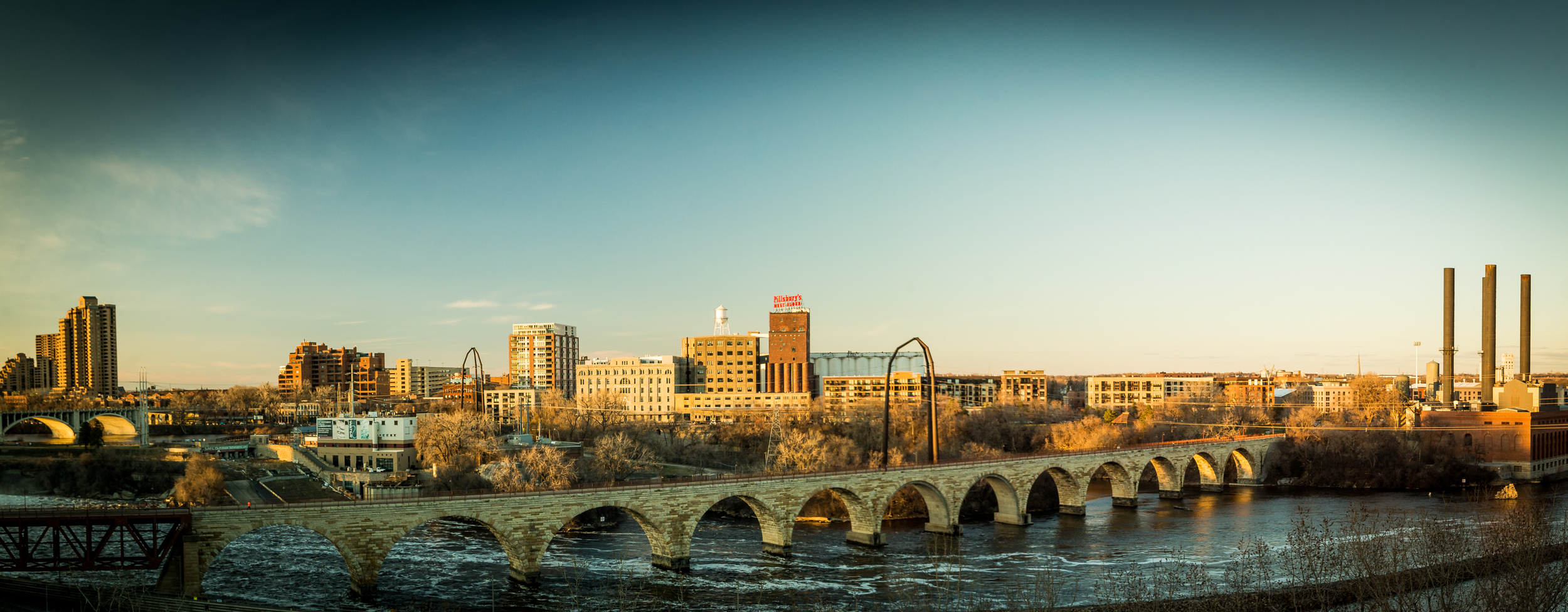 St. Anthony Falls. Taken from the Endless Bridge at the Guthrie Theater.                 1/100 sec @ f/7. w/ISO 400. 35mm 2 Image Panorama