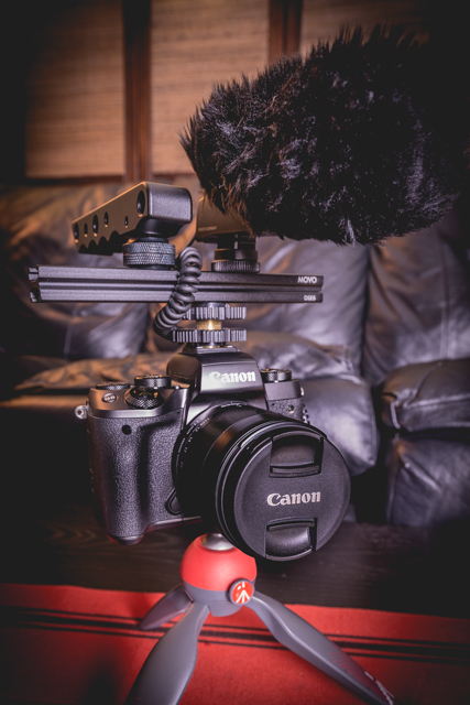 Canon EOS M5 Mirrorless Camera w/ attached 11-22mm f/4 lens and Manfrotto PIXI mini tripod.. Rig consists a slider mount, Sennheiser MKE400 microphone w/ windscreen, and top handle