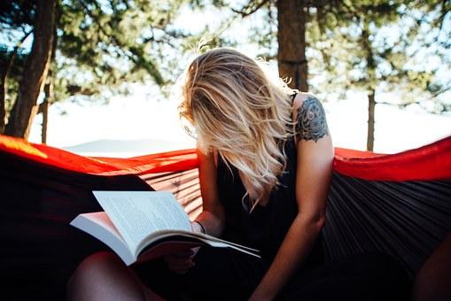 This gal is reading CONCERNING GEORGIA STEKKER.