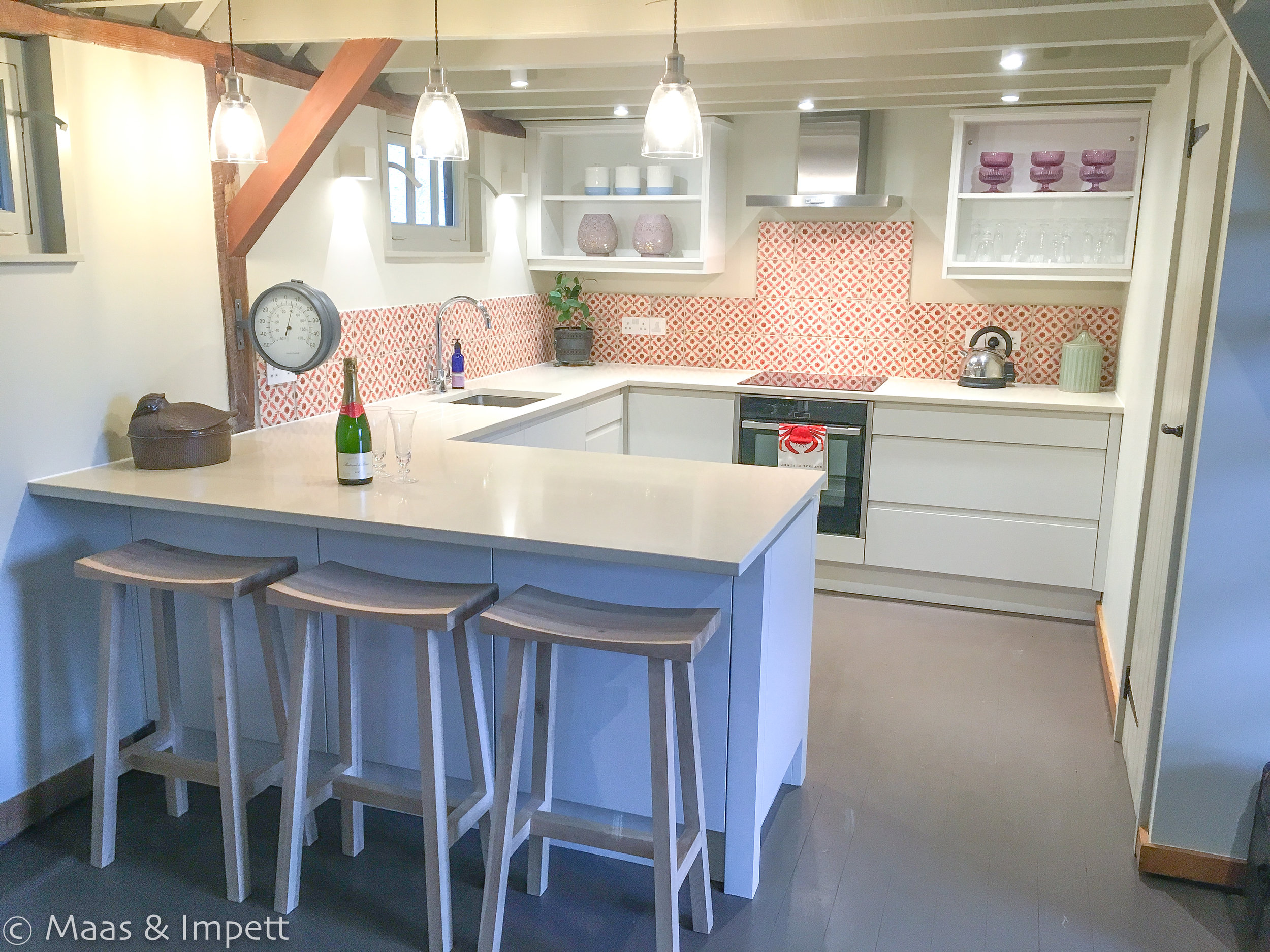 Bespoke Kitchen carpentery by Raynsford and stunning tiles sourced from Fired Earth. Bar Stools to compliment the clean lines, Garden Trading.