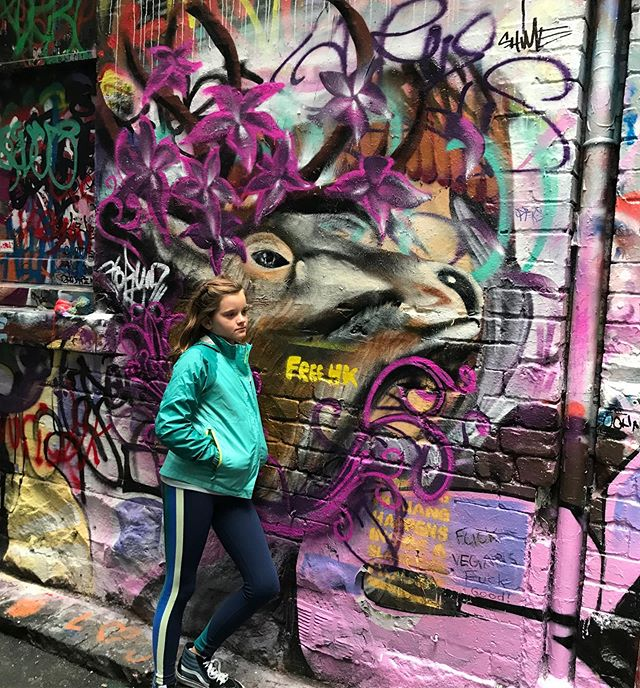This girl turns 11 today. Yesterday, just before our flight home, we roamed the alleys of downtown #Melbourne in search of this, Hosier Lane, graffiti El Dorado. It was a drizzly day and the place was oddly difficult to find, in the #platform9¾ sense, but she persevered and pulled me into its alcoves and plot twists. Hosier was like an urban underwater reef, teeming with color and strangeness and possibility, hard edges and soft gradations of light. Like so much else we encountered in #Australia, this was reality shot with high-octane fantasy. My birthday wish for Aria: Keep wandering the back alleys and reaching for the wrasse, finding the softness and pushing the hard edges of things, expanding reality with fantasy and shifting what -is- with what's possible. We got home last night. The trip's over but the adventure's just begun. #Happybirthday Aria Lyon Little, LOVE FLAMBÉ! #nofilter