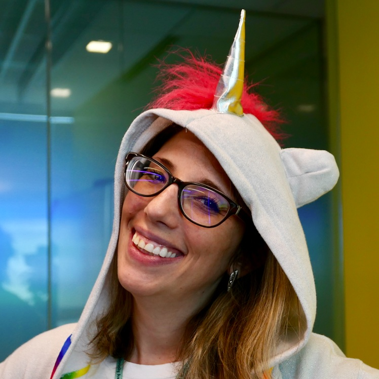 Lexi sports a unicorn horn on Bring Your Kids to Work Day