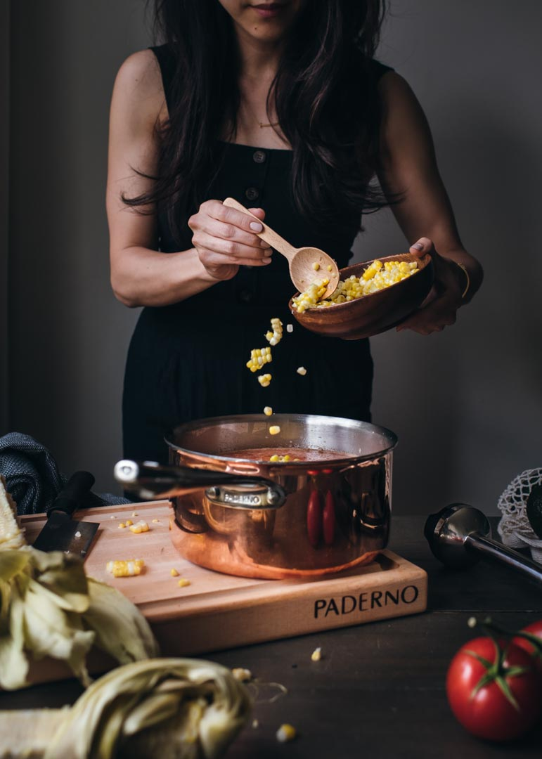 Paderno copper-clad cookware and Paderno Maple Chopping Board.