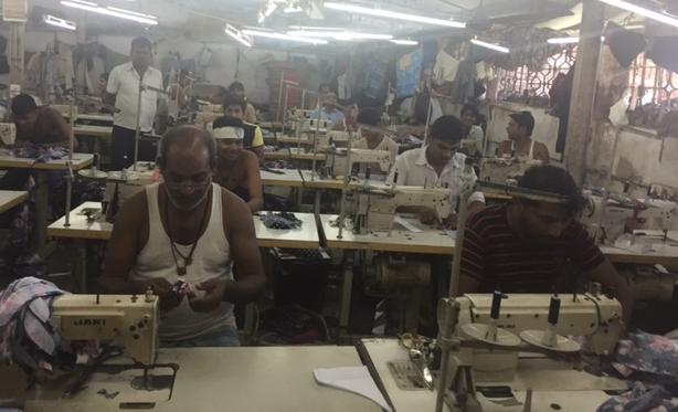 Garment stitchers in the Dharavi slum in Mumbai, Maharashtra, India.