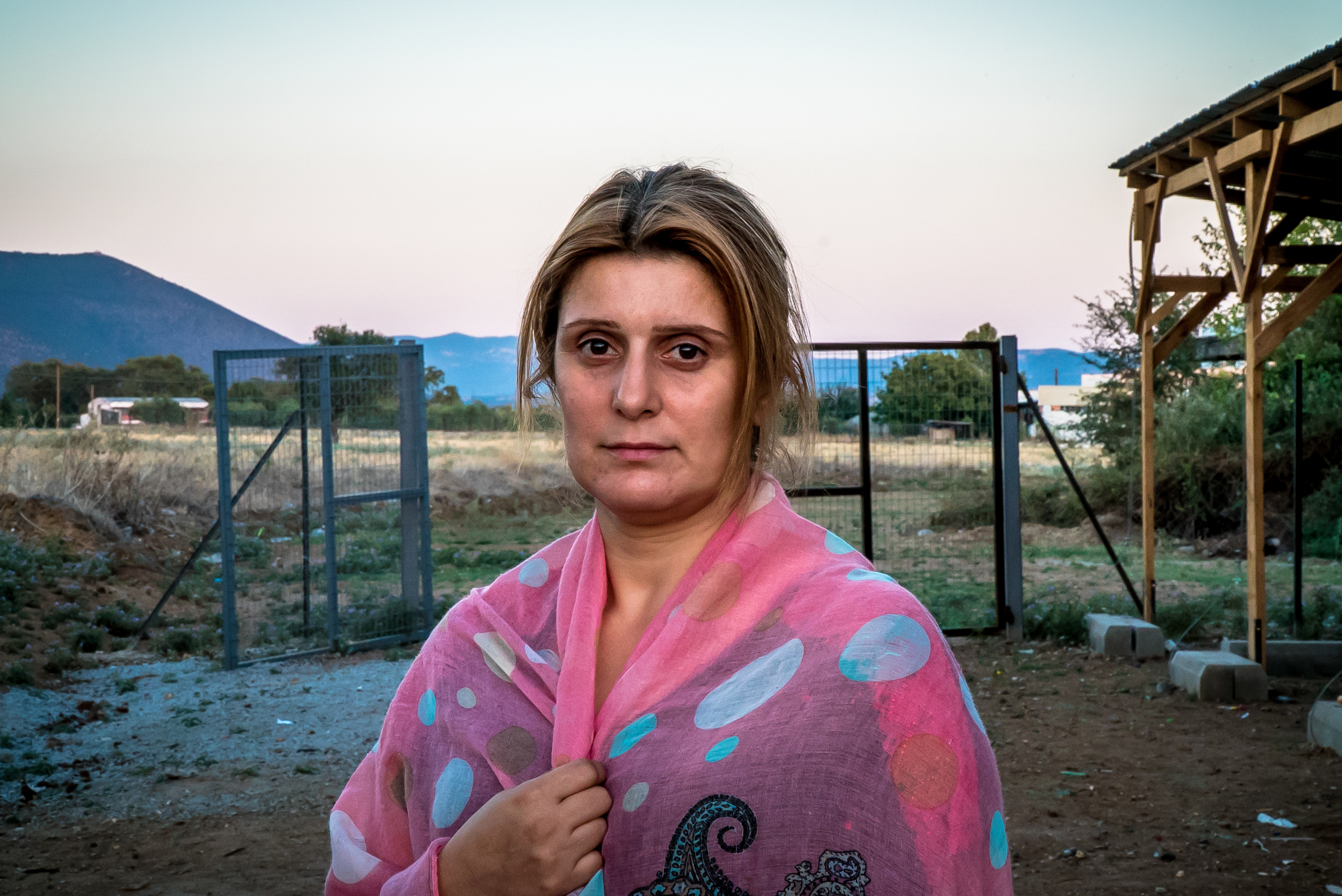 Photo taken 8/14/16. Hevin, a widowed single mom and former arts teacher in Vasilika Camp. She's been here for 2 months with her 3 children. With the current political policies in place, she can neither move forward across the border to get to Germany where she had hoped to work, or go back.