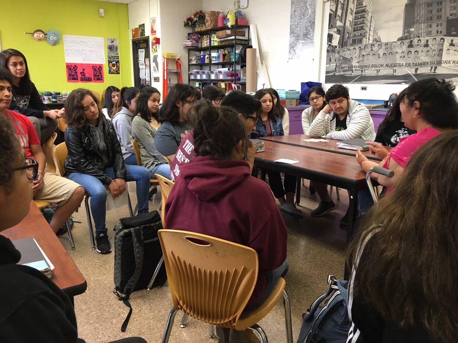 Dr Sandra Mendez talks to maestra Paulina Camacho and her students at Benito Juarez about the protests at Froebel School in 1973, which paved the way for the eventual commitment from Mayor Daley to build Benito Juarez High School. (2018)
