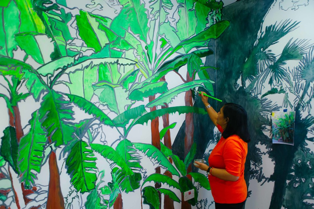 Sutapa Biswas at work on her mural in the Women's Quiet Room at Garnet Ward. Photography by Jennifer Moyes